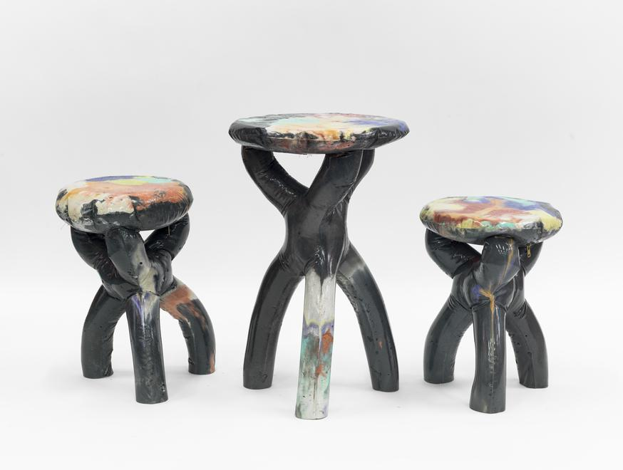 group of black concerete stools and side table, 20...